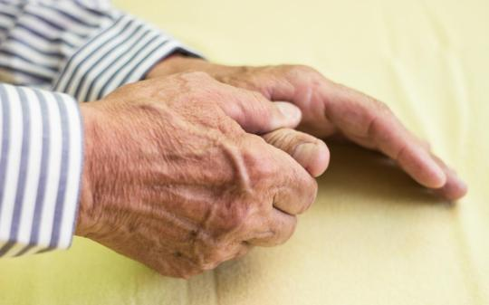 elderly-man-s-hand-one-hand-holding-the-thumb-of-the-other-due-to-arthritis-pain